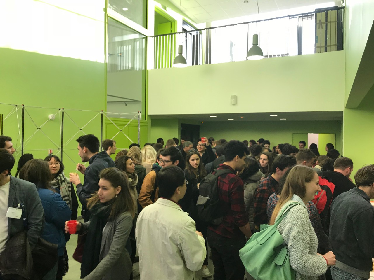 UB and UC students socializing after UC students presented work in Bordeaux