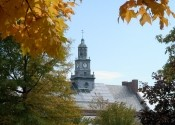 Picture of the top of McMicken on a Fall day, leaves on the surrounding trees are yellow and red