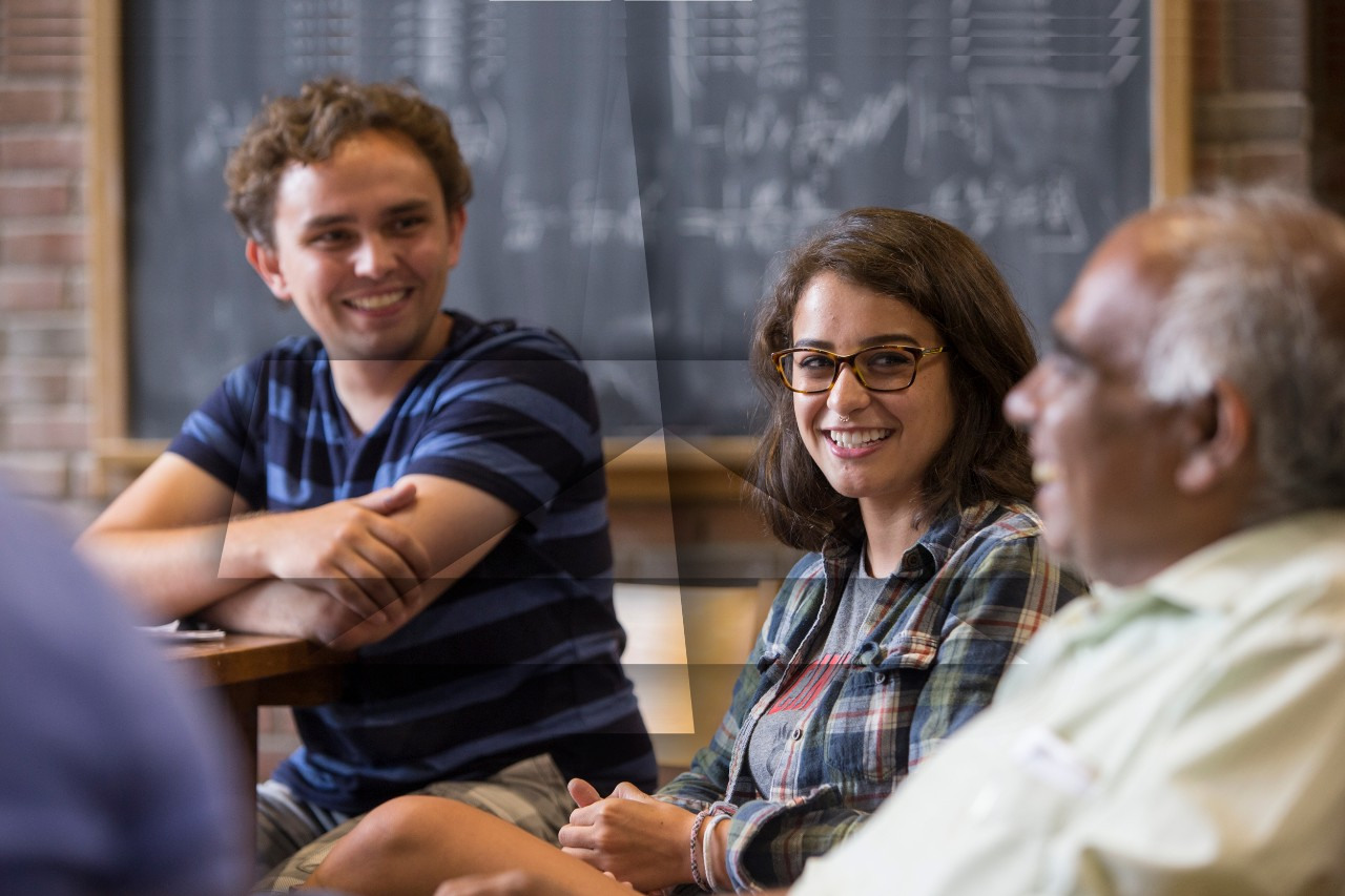 Students conversing in a classroom
