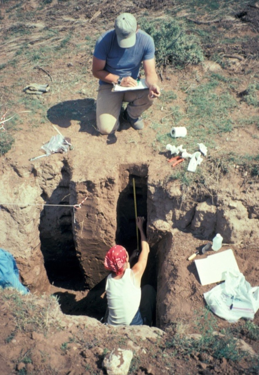Image of a man and a woman working at an archeology dig site